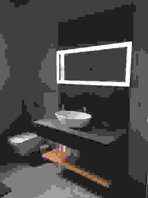 Baños de estilo  por Graftink Interior and Architectural Design Studio , Moderno