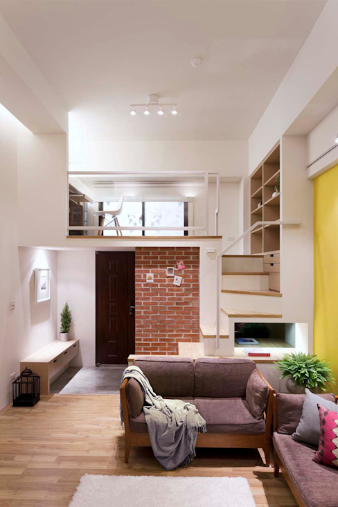 Living room by 吉畝室內裝修有限公司
