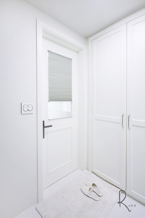 로하디자인 Walk in closets de estilo mediterráneo