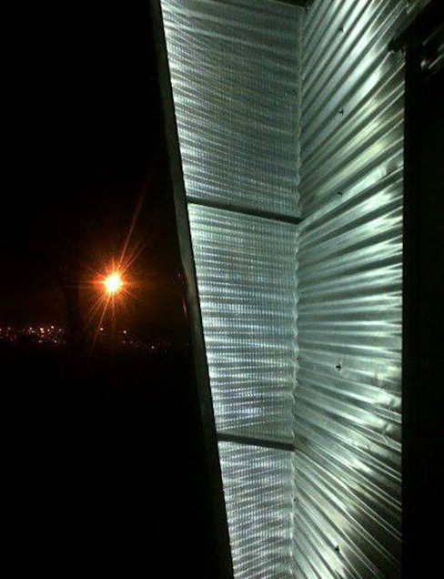 Exterior facade lighting:  Houses by A4AC Architects,