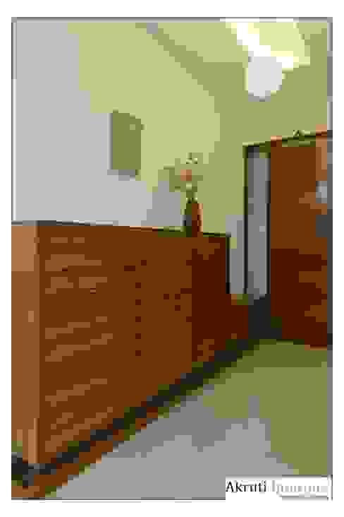 Entrance Lobby: modern  by Akruti Interiors Pune,Modern Plywood