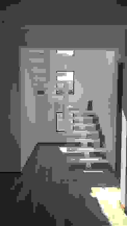 Pasillos, vestíbulos y escaleras de estilo moderno de homify Moderno Concreto