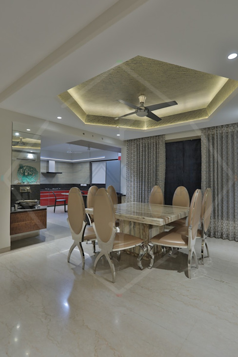CAPITAL GREEN-2:  Dining room by SPACCE INTERIORS