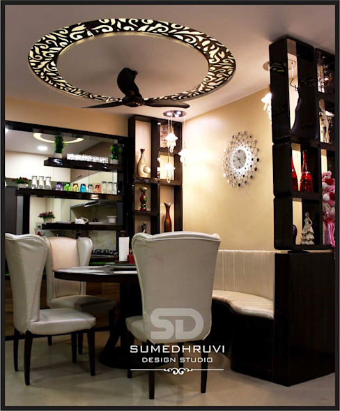 Dining Area Specifying Round Table with Chairs and Ledge Seating SUMEDHRUVI DESIGN STUDIO Modern dining room