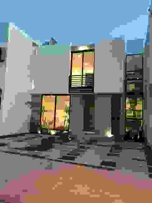 Fachada Principal Atardecer Casas modernas de Alfagrama estudio Moderno Caliza