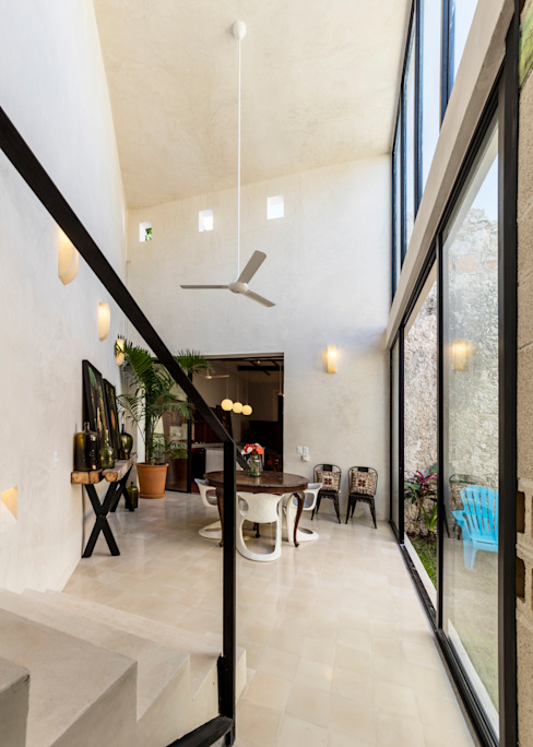 Столовая комната в стиле модерн от Taller Estilo Arquitectura Модерн