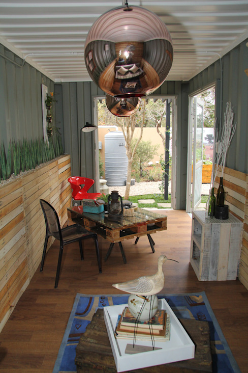 Container living space with garden view by Acton Gardens Industrial