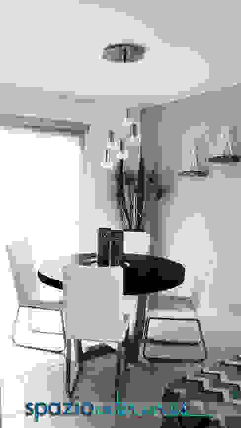 Dining room by spazio interiores,