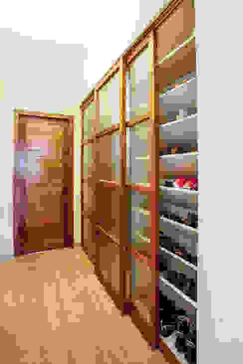 Walk-in Footwear Closet Modern corridor, hallway & stairs by The Workroom Modern