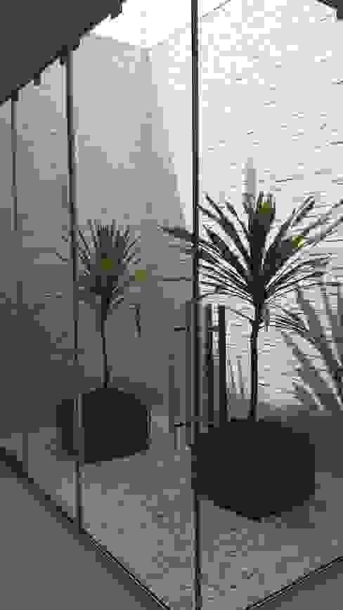 Carla Monteiro Arquitetura e Interiores Modern style conservatory Stone