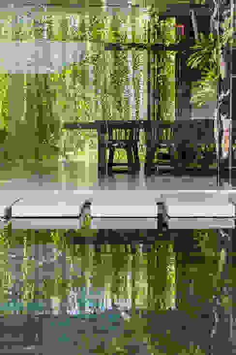 Hoteles de estilo  por MIA Design Studio