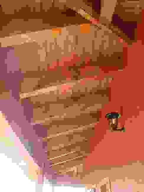 Ampliación de casa con quincho y piscina en Calera de Tango, por DAMRA de DIEGO ALARCÓN & MANUEL RUBIO ARQUITECTOS LIMITADA Rústico