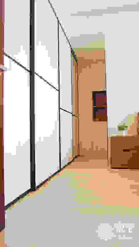 Vestidores y placares de estilo ecléctico de 樂宅設計|系統傢俱 Ecléctico