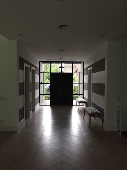 CASA EN TORTUGAS CC-HALL DE ACCESO Pasillos, vestíbulos y escaleras clásicas de Estudio Dillon Terzaghi Arquitectura - Pilar Clásico Hierro/Acero