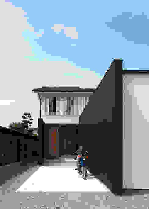 Casas de madera de estilo  por 伊藤憲吾建築設計事務所,