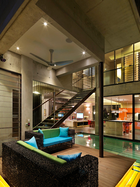 Lounge and Interior Pool by MJ Kanny Architect Modern