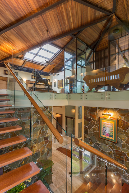 Glass stairs by MJ Kanny Architect Tropical
