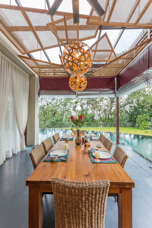 Dining space overlooking the Pool Tropical style dining room by homify Tropical