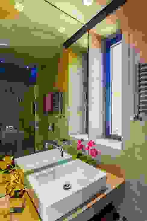 Borgo 48 Arabella Rocca Architettura e Design Bagno eclettico Cemento Ambra/Oro