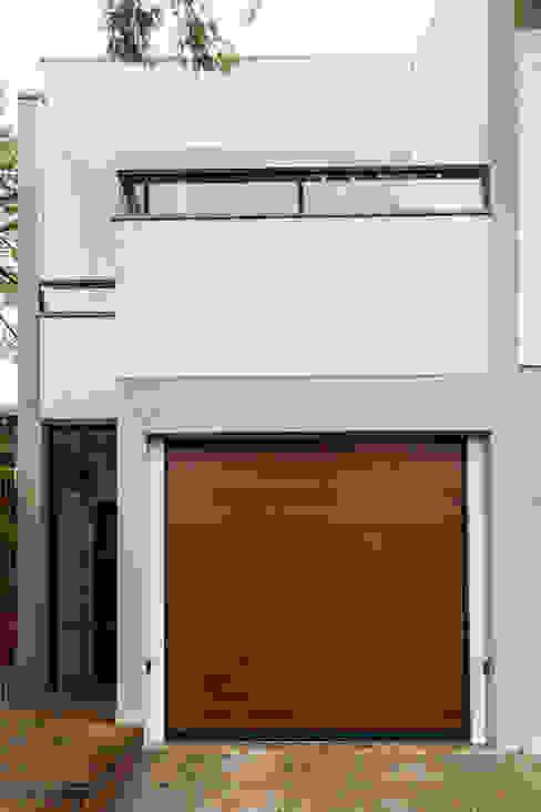 Casas unifamiliares de estilo  por Graziela Alessio Arquitetura, Minimalista Cerámico