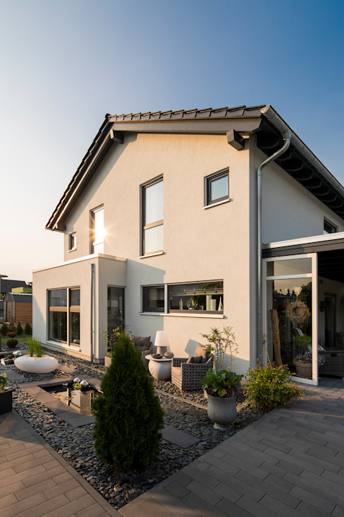 Classic style houses by FingerHaus GmbH - Bauunternehmen in Frankenberg (Eder) Classic