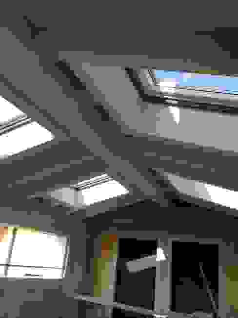 velux e tetto travato Architetti Baggio Villa a schiera