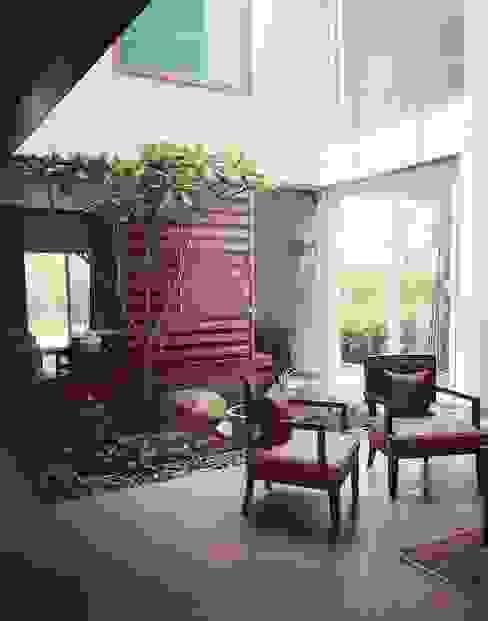 Salas de estar  por Crafted Spaces