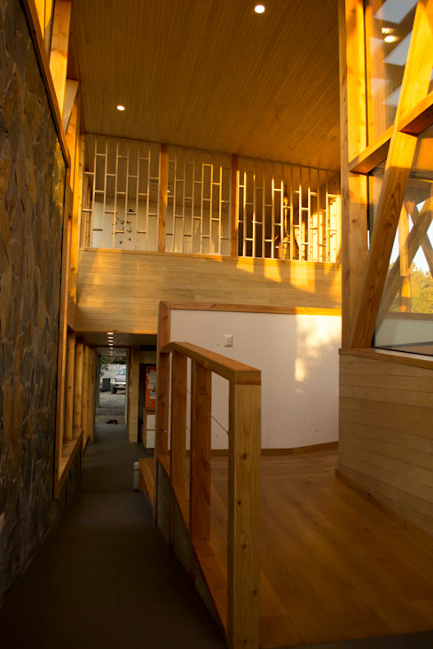 Hall de entrada homify Pasillos, vestíbulos y escaleras modernos Concreto Acabado en madera