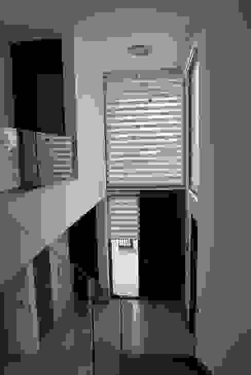 Modern Corridor, Hallway and Staircase by DARQ studio Modern
