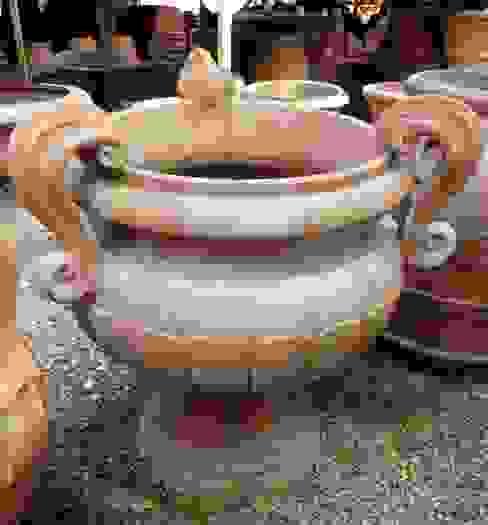 Vasi, fioriere, fontane, statue e tanto altro ancora Tonazzo Srl GiardinoFioriere & Vasi Arancio