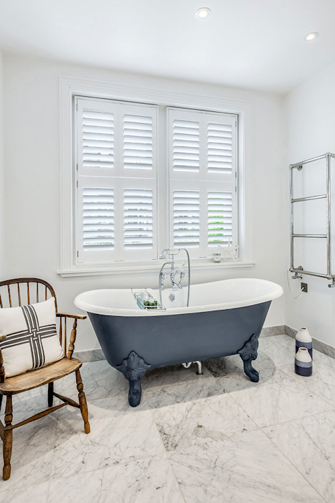 Tier on Tier Shutters in the Bathroom:  Bathroom by Plantation Shutters Ltd,