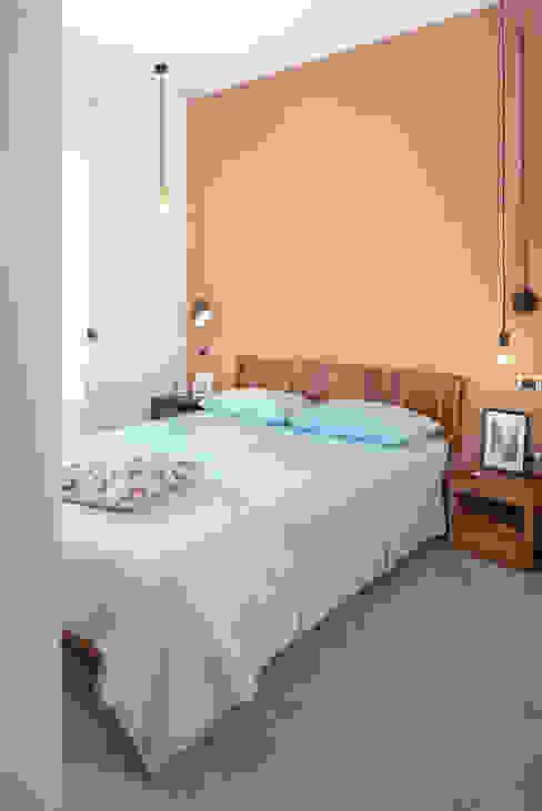 Habitaciones de estilo  por manuarino architettura design comunicazione, Industrial Madera Acabado en madera
