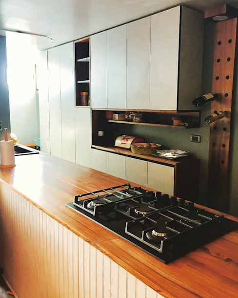 Nhà bếp phong cách hiện đại bởi MMAD studio - arquitectura interiorismo & mobiliario - Hiện đại