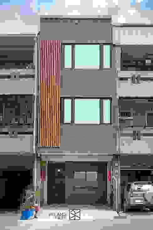 Casas unifamiliares de estilo  por 禾廊室內設計,