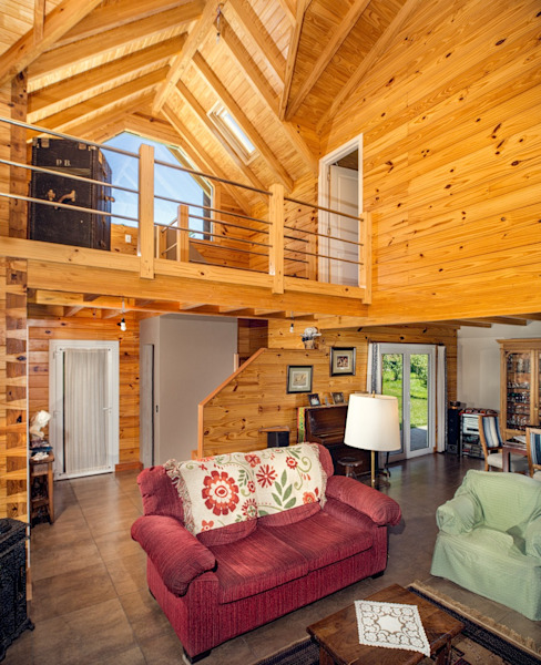 Patagonia Log Homes - Arquitectos - Neuquén Livings de estilo clásico Madera maciza Acabado en madera
