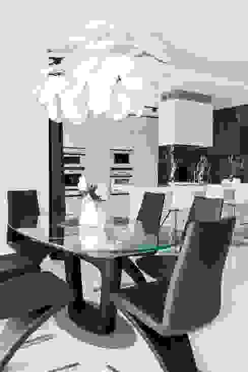 Modern dining room by Geometrix Design Modern