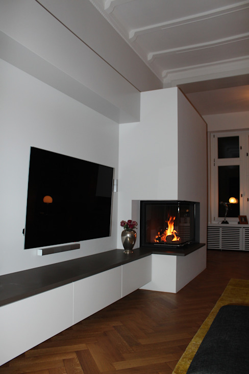 Modern living room by Christoph Lüpken Ofenbau GmbH - Kamine aus Duesseldorf Modern