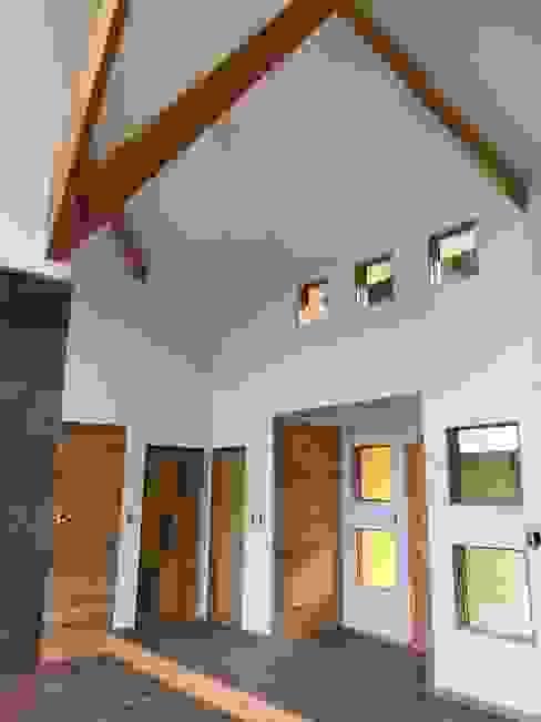 Vista Living Hall Acceso Nomade Arquitectura y Construcción spa Livings de estilo clásico Madera Acabado en madera