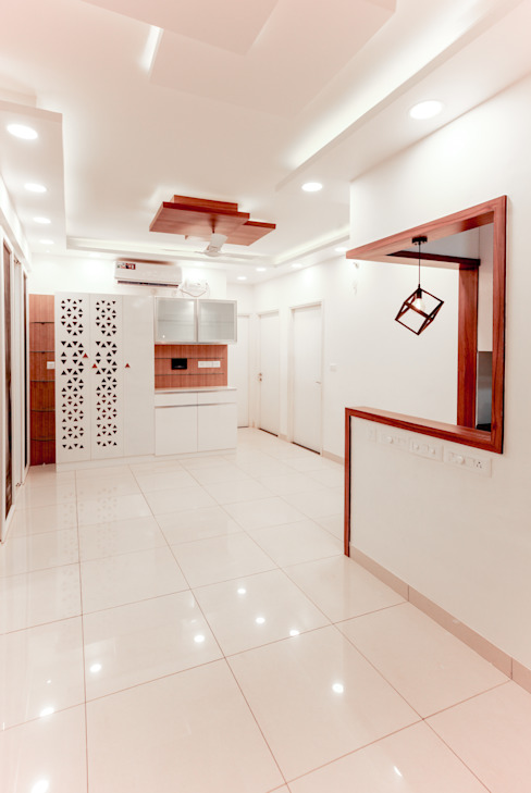 The Dining Room with the Crockery cum Puja Unit visible : modern  by U and I Designs,Modern