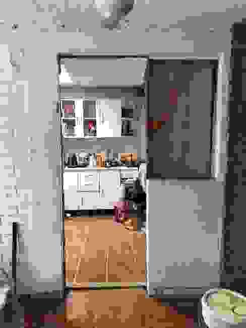 Muro divisor comedor / cocina de Oscar Saavedra Diseño y Decoración Spa Rústico