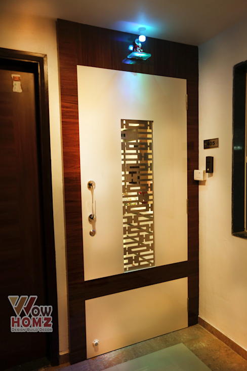 Safety Door :  Living room by Wow Homz,