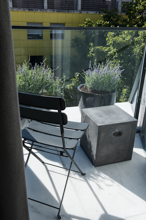 Varanda por Inêz Fino Interiors, LDA Moderno