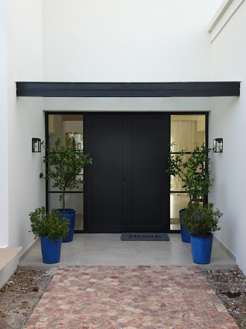 Entrada principal de Estudio Dillon Terzaghi Arquitectura - Pilar Clásico Hierro/Acero