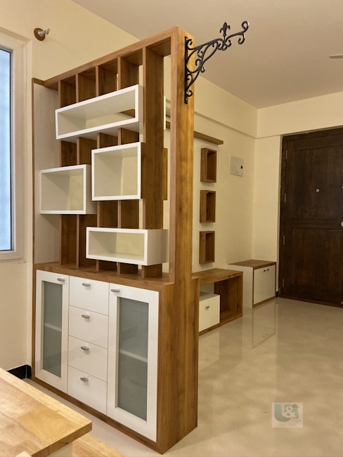 Crockery Unit that also serves as a designer partition between the living & dining : modern  by U and I Designs,Modern Plywood