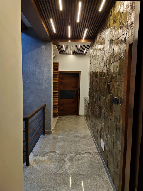 Hallway designed with stone cladding on wall and asymetric wooden ceiling with linear lighting Modern corridor, hallway & stairs by Enwave Modern