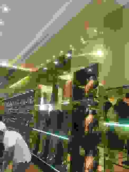 Golden laminate Asian style walls & floors by DezinePro Asian