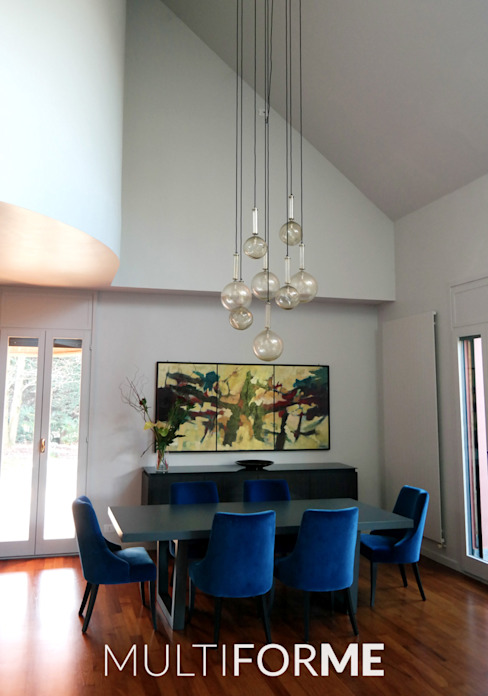 Custom chandeliers in Murano glass for a Private Flat in Milan, Italy por MULTIFORME® lighting Moderno Vidro