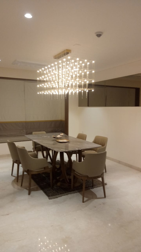 Interior work of 4.5 BHK apartment in kharadi, pune Modern dining room by Exemplary Services Modern