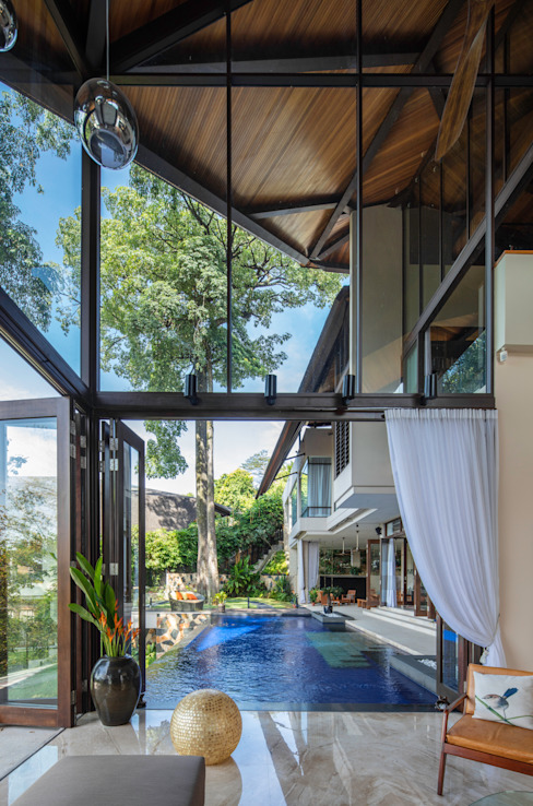 View out to pool by MJ Kanny Architect Tropical