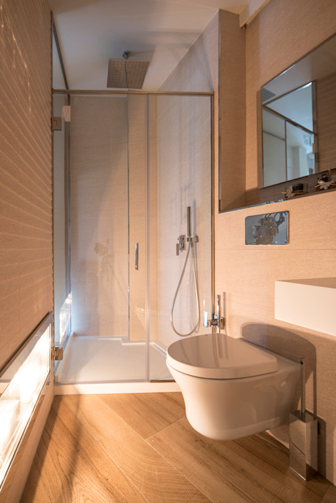 Decoración de Baño con chimenea integrada. Baños de estilo moderno de Antonio Calzado 'NEUTTRO' Diseño Interior Moderno Caliza